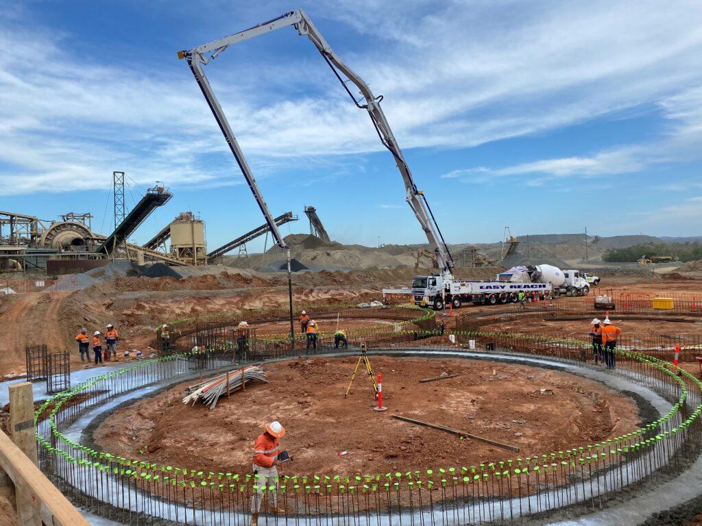 52m concrete placing boom placing concrete at mine site