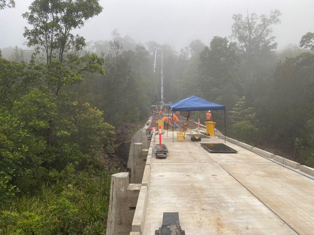 52m concrete placing boom placing concrete at Tully River Bridge